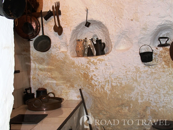 Matera - Casa Grotta Casa Grotta  the family's kitchen. Niches were carved into the cave walls for storage.