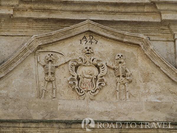 Matera - Purgatorio Church Skeleton decor on the facade of the Purgatorio Church.