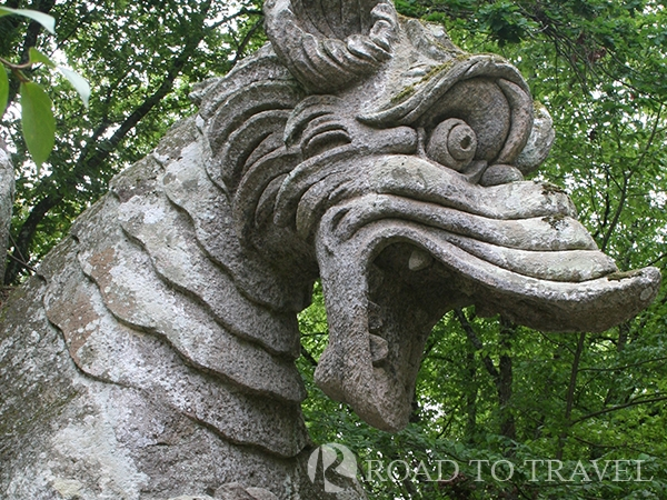 Dragon with Lions - Parco dei Mostri The Dragon attacked by Lions is one of the main sculpure inside the Bomarzo Gardens.