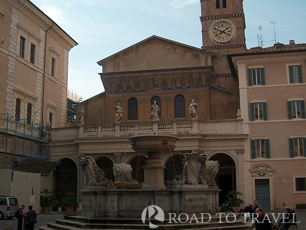 Trastevere The church and the fountain in Piazza Santa Maria in Trastevere Rome.  One of the top 10 things to do I Rome is lovely walking tour of Rome by night from Piazza Navona to Trastevere. This nice walk through the illuminated historical building and tipical bar, restaurants and local vinery takes only 40 minutes. You will pass through Piazza Campo dei Fiori, and Piazza Farnese continue to Palazzo Spada and via dei Pettinari, cross the Tiber on the pedestrian bridge Ponte Sisto and stroll to the narrow typical streets of Trastevere till Piazza Santa Maria in Trastevere.