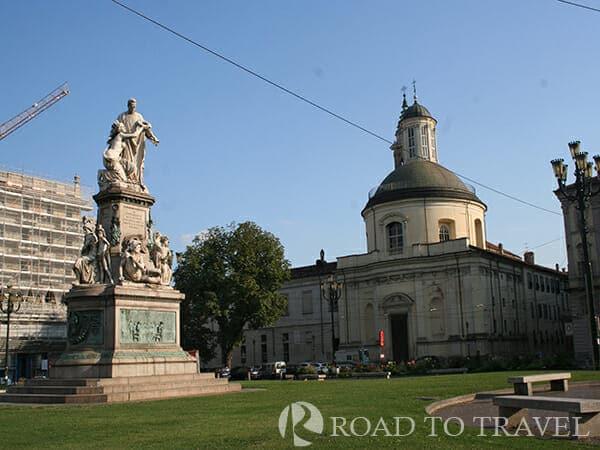 Piazza Carlo Emanuele II A view the monument of Benito Benso, conte di Cavour and of Santa Croce Church in Piazza Carlo Emanuele II Turin Italy